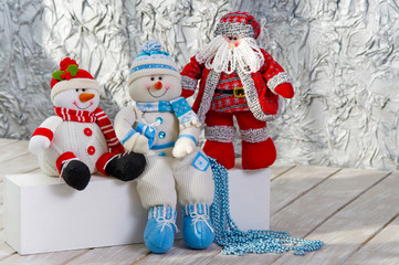 Two toy snowmen and Santa Claus Christmas decoration