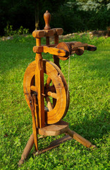 Spinning wheel on green grass