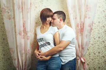 Newlyweds hugging