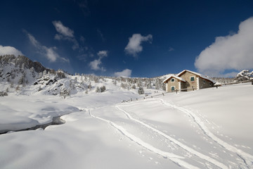 Alpine hut in winter scenic landscape