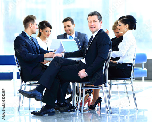 Portrait of mature business man smiling during meeting