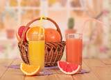 Orange and grapefruit juice in glasses