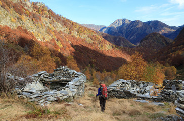 Hiker in autumn landscape