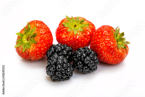 strawberries and blackberries on a white background