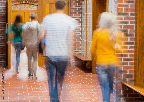 Blurred students walking through corridor