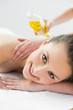 Portrait of beautiful woman enjoying oil massage