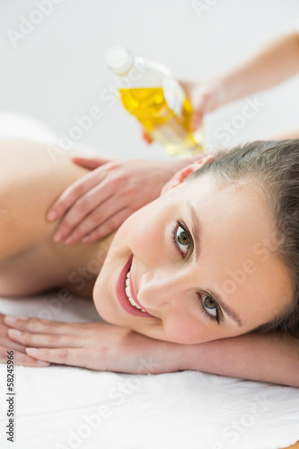 Portrait of beautiful woman enjoying oil massage