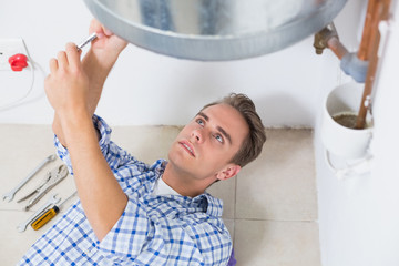 Technician servicing an hot water heater