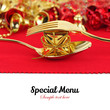 Christmas golden cutlery with ornament on red background