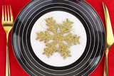 Christmas golden snowflake on a plate
