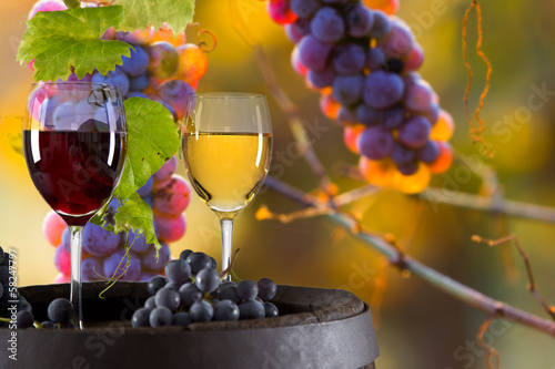 Wine bottle and glasses on wooden table - 58247797