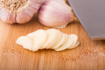 Sliced Garlic on the cutting board