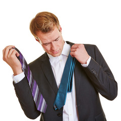 Business man choosing a tie