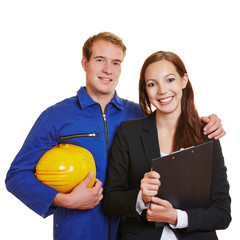Worker and business woman in a team