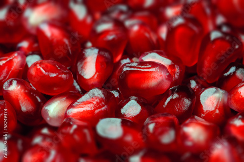 Pomegranate seeds close up macro studio shot