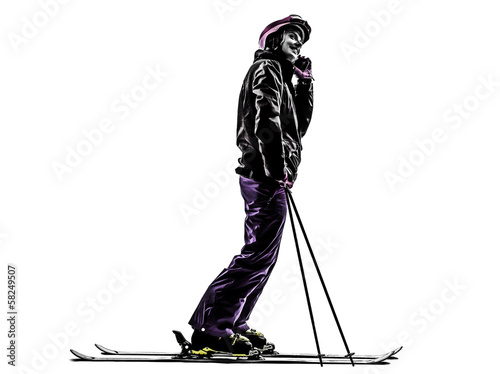 one woman skier skiing on the telephone silhouette
