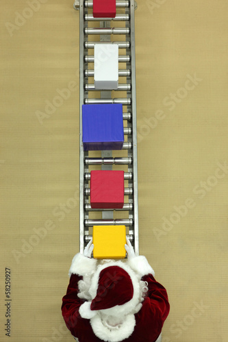 santa clause working at conveyor belt in presents factory