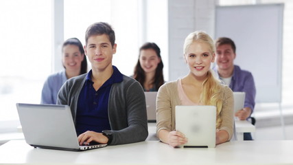students in computer class showing thumbs up