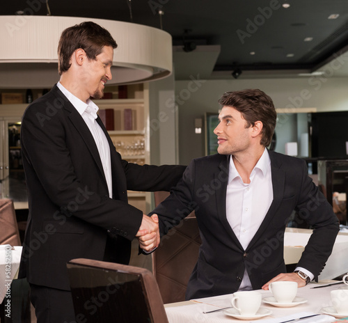 Business meeting of two successful business men