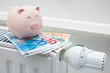 canvas print picture - Heating thermostat with piggy bank and money