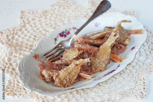 Fried fish marinated with onions
