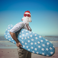 funny santa claus surfer beach