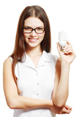 woman in glasses holding lamp