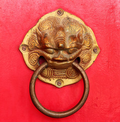 vintage door handle on red door  Thai temple