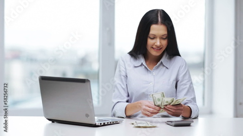 woman with calculator counting us dollar money