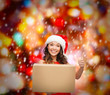 smiling woman in santa helper hat with parcel box