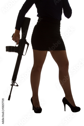 Dangerous woman in black with assault rifle