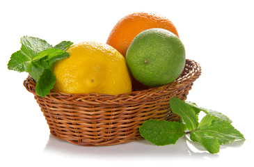 Lemon, lime, orange in a wicker basket