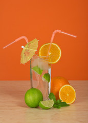 Drink in glass with straw, is decorated umbrella