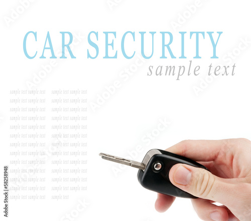 Hand holding car keys isolated on white background