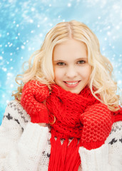 smiling teenage girl in red mittens and scarf