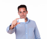 Gorgeous hispanic man holding a blank card