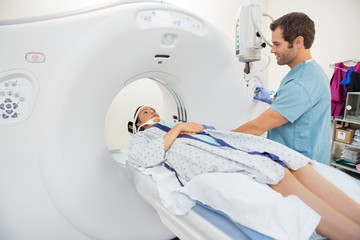 Nurse Preparing Patient For CT Scan Test