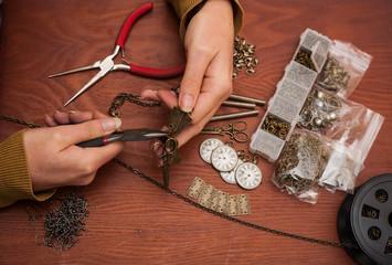 hands making craft jewellery