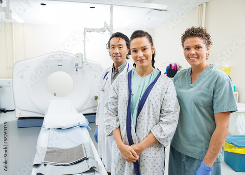 Medical Team With Patient In CT Scan Room