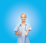 smiling doctor or nurse offering pills and water