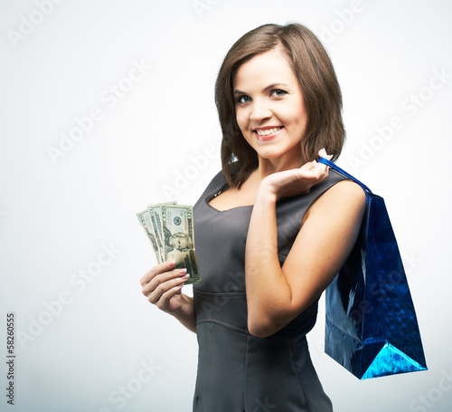 Attractive young woman in a gray business dress. Holds a gift ba