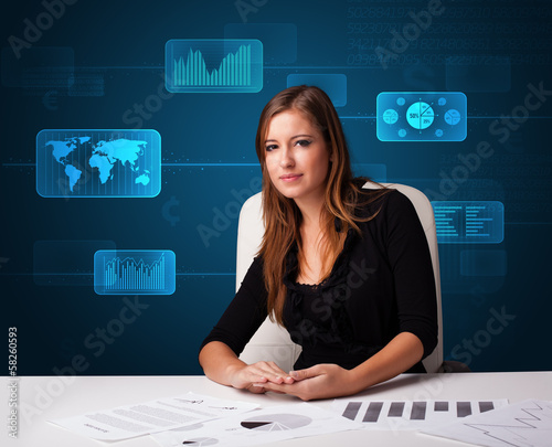 Businesswoman doing paperwork with digital background