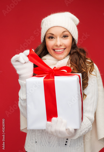smiling woman in white clothes with gift box