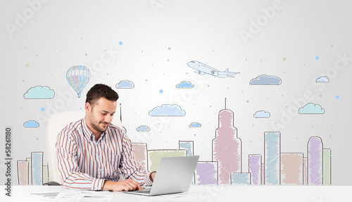 Attractive businessman with city sky-scape background