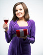 Attractive young woman in a lilac dress. Holding a glass of wine