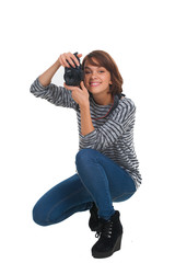 Lovely teenage girl with photo camera