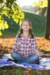 Girl meditating in the park