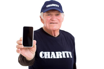 elderly charity volunteer showing smart phone
