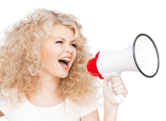 woman with long curly hair holding megaphone