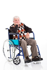 disabled senior man sitting on a wheelchair